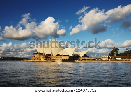 SYDNEY, AUSTRALIA - JULY 6 : The Sydney Opera House as seen from the Sydney Harbour Ferry on July 6, 2012. A multi-venue arts center designed by Danish architect Jorn Utzon. Opned in 1973. - stock photo