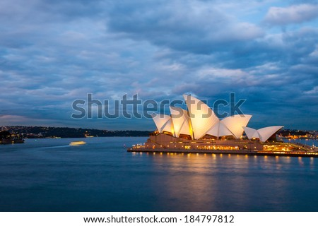 Sydney, Australia - July 12, 2010 : View of the Sydney Opera House with nice clouds, sky background at blue night. - stock photo