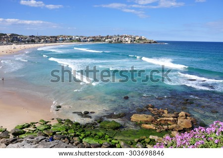 SYDNEY, AUSTRALIA - JUN 25, 2015. People relaxing at Bondi beach in Sydney, Australia. Bondi beach is one of a famous beach in the world. - stock photo
