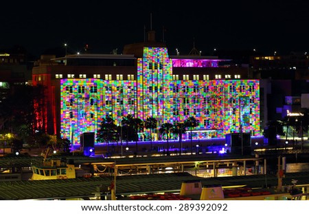 SYDNEY, AUSTRALIA - JUNE 3, 2013;  Museum of Contemporary Art Building alive with colour and light during Vivid Sydney.    Multicolour rainbow blocks like a rubics cube - stock photo