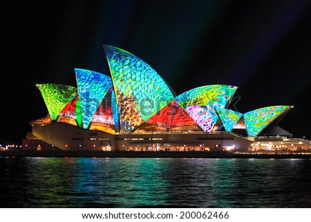SYDNEY, AUSTRALIA - JUNE 2, 2014;  Sydney Opera House in bright colours during Vivid Sydney annual festival of light, music and ideas