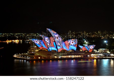 SYDNEY, AUSTRALIA - 14 JUNE 2013: The Sydney Opera House is being illuminated with art by various artists during the annual Vivid Sydney Festival on June 14, 2013 - stock photo