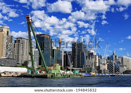 SYDNEY,AUSTRALIA - MARCH 9,2014: Construction of the Crown Casino under way at Barangaroo. 3 days later, a blaze on the site set the A$6 billion project back by months and brought chaos to the city. - stock photo