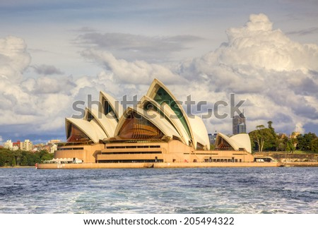 SYDNEY, AUSTRALIA - MAY 20, 2010: A view of Sydney Opera House from the water. With its interlocking roof or 'shells' it is Australia's most recognisable building and a UNESCO World Heritage Site.