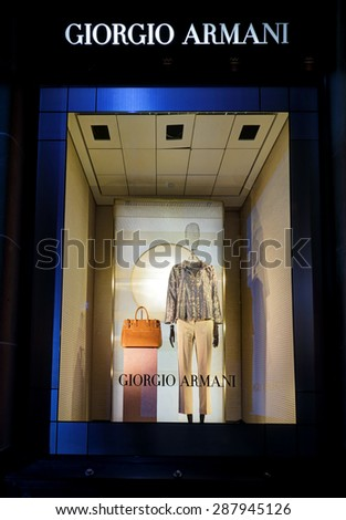 SYDNEY, AUSTRALIA, MAY 26, 2015;  One of the retail shop window displays in Martin Place, a mannequin wearing womens clothing and accessories - visual merchandising of Giorgio Armani, Sydney - stock photo