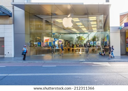 SYDNEY, AUSTRALIA - MAY 15: People shop at Apple shop on May 15, 14 in Bondi, It's an American corporation, designs, develops, and sells consumer electronics, computer software and online services. - stock photo