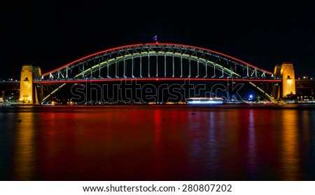 SYDNEY, AUSTRALIA - MAY 21, 2015; Sydney Harbour Bridge lights preview for Vivid Sydney 2015, shown here illuminated in red - stock photo