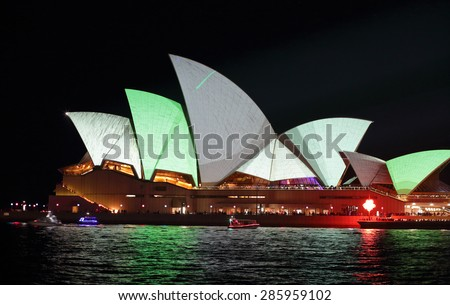SYDNEY, AUSTRALIA - MAY 23, 2015;  Sydney Opera House  illuminated in metallic grey and green colours during Vivid Sydney annual festival.
