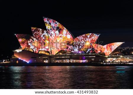Sydney, Australia - 2016, May 27: Sydney Opera House illumination Lighting the Sails Songlines created by four aboriginal artists. Outdoor lighting festival Vivid Sydney - stock photo