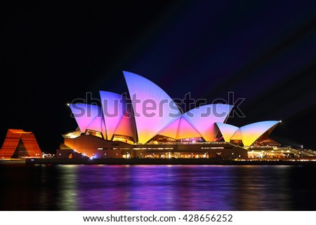 SYDNEY, AUSTRALIA - MAY 29, 2016;  Sydney Opera House in moving colour of patterns, shapes and lines during the Vivid Sydney Annual Event.  Showing pretty sunrise colours on the sails Opera House.