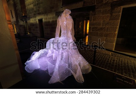 SYDNEY, AUSTRALIA - MAY 26, 2015;  The Dresses shapes hundreds of fibre-optic strands into the form extravagant dresses, they appear as apparitions,  Artist Tae Gon Kim - stock photo