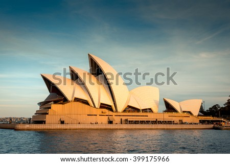 Sydney, Australia - November 10, 2016:  Opera House at sunset. View from the arriving ferry. Color toning effects applied. - stock photo