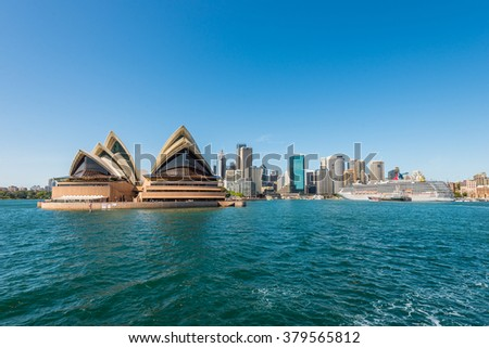 SYDNEY, AUSTRALIA - NOVEMBER 8, 2014: The Sydney Opera House and the Circular Quay cruise terminal at Sydney, Australia. Cityscape of Sydney Downtown.