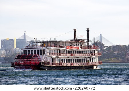 SYDNEY,AUSTRALIA - OCTOBER 31,2014: A paddlewheeler cruises along the harbour.  Sydney Showboats have carried over 6 million guests since 1987. - stock photo