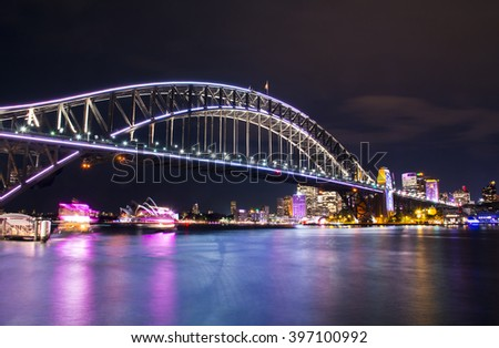 Sydney, Australia â?? October  11, 2015: Long exposure of the Sydney Opera House and Harbor Bridge Illuminated at Night.  - stock photo