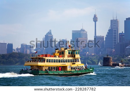 SYDNEY,AUSTRALIA - OCTOBER 24,2014: One of Sydney's iconic ferries heads towards Circular Quay. The 28 vessels handle a total of 15 million passenger trips per year.