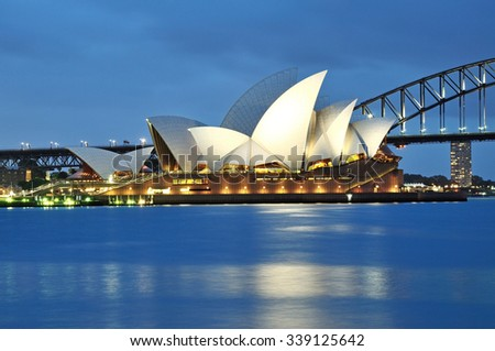 SYDNEY, AUSTRALIA - OCTOBER 18, 2015: The Sydney Opera House during blue hour viewed from Mrs Macquarie's point in Sydney. The Sydney Opera house is iconic landmark in Sydney Australia.