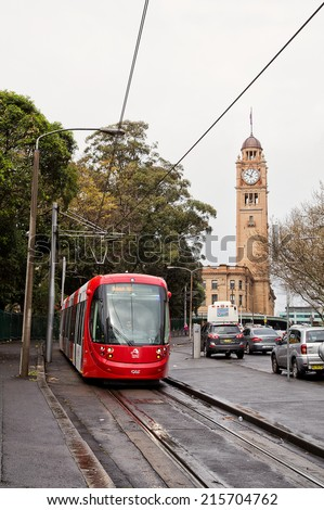 SYDNEY,AUSTRALIA - SEPTEMBER 7,2014: A tram on the light rail network leaves Central Station. A $1.6B expansion of the network is currently under way. - stock photo