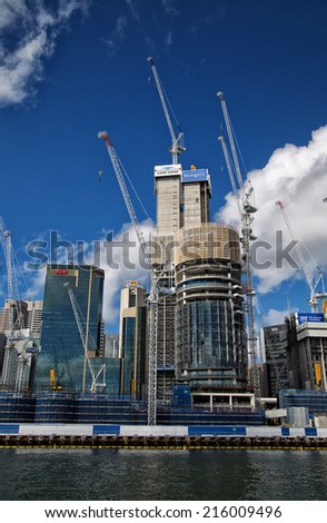 SYDNEY,AUSTRALIA - SEPTEMBER 7, 2014: Construction progressing at Barangaroo. The A$6B project includes a waterside park, commercial and residential buildings and a casino. - stock photo