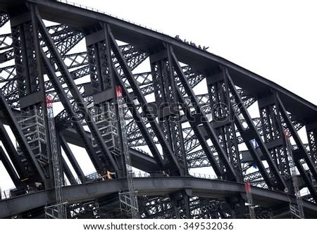 SYDNEY, AUSTRALIA - SEPTEMBER 11, 2009: Unidentified climbers on Harbour Bridge. Bridge climbing is truly unforgettable experience. - stock photo