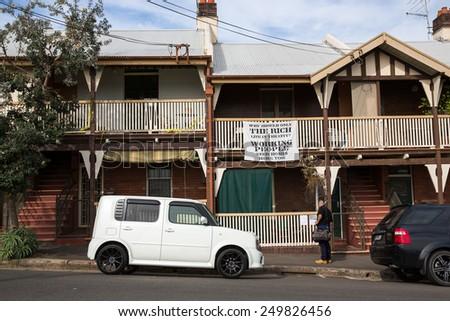 Sydney, Australia - September 19: View of old houses in the Rocks neighbourhood in Sydney, Australia on September 19, 2014. - stock photo