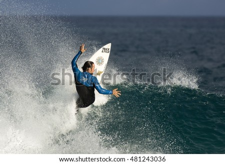 Sydney, Australia -September 10, 2016. Young surfer surfing at Tamarama beach