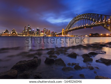 sydney city CBD harbour bridge landmarks at sunset view from harbour water low tide