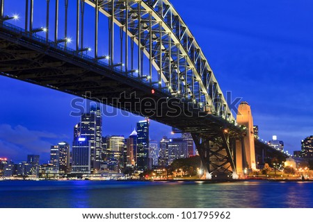 Sydney city cbd sunset close up view with lights and illumination view from under the bridge - stock photo
