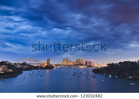 sydney city CBD sunset stormy weather cloudy sky - stock photo