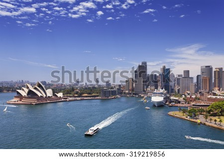 Sydney city landmarks in Australia on a bright summer sunny day from Harbour bridge looking out on ferries and ships around CBD and circular quay