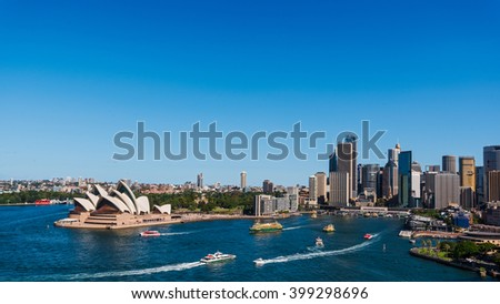 Sydney city skyline shot from Harbor Bridge including quay, skyscrapers and several ships - stock photo