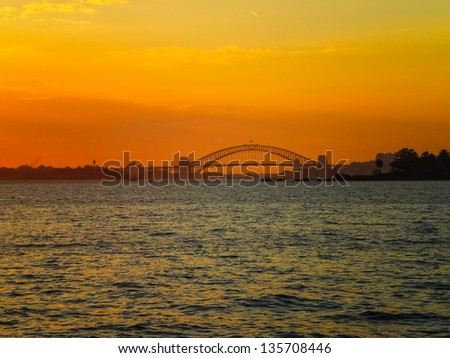 Sydney city with golden sky in the evening - stock photo