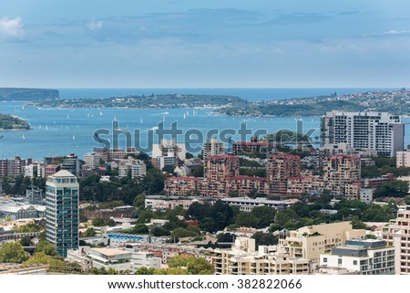 Sydney harbor with ships and yachts and adjacent buildings from height