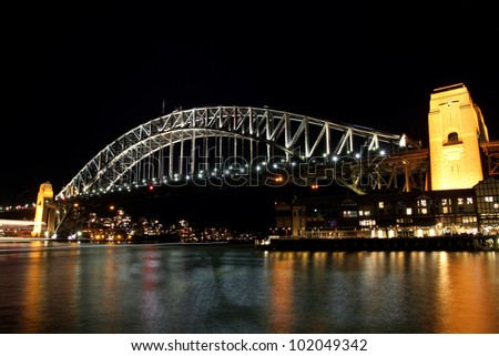 Sydney Harbour Bridge at night viewed from Walsh Bay - stock photo