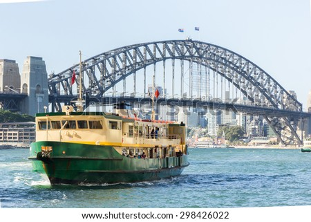 Sydney Harbour City Ferry in Circular Quay with Sydney Harbour Bridge background - stock photo