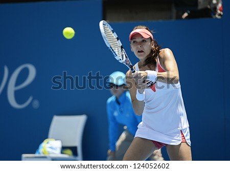 SYDNEY - JAN 9: Agnieszka Radwanska from Poland hits a backhand in her quater final match in the APIA Sydney Tennis International. Sydney January 9, 2013. - stock photo