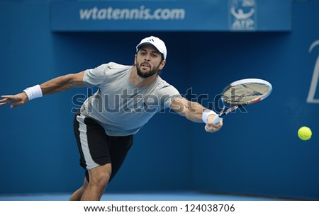 SYDNEY - JAN 9: Fernando Verdasco reaches to return serve during his second round match in the APIA Sydney Tennis International. Sydney January 9, 2013. - stock photo