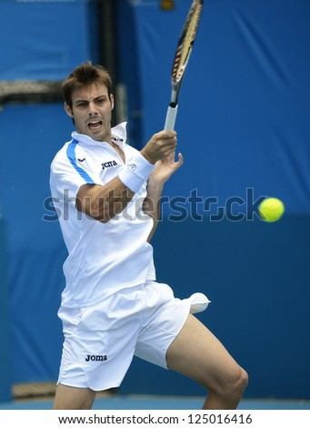 SYDNEY - JAN 9: Marcel Granollers from Spain hits a forehand at the APIA Sydney Tennis International. Sydney January 9, 2013. - stock photo