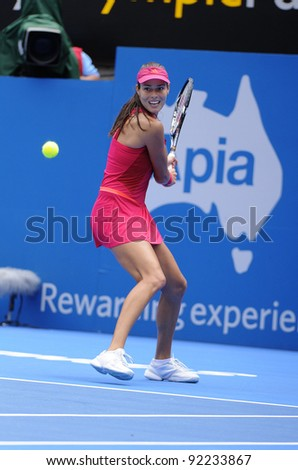 SYDNEY - JAN 8: Serbian Ana Ivanovic hits a backhand during her first round match in the APIA Tennis International. Sydney - January 8, 2012 - stock photo