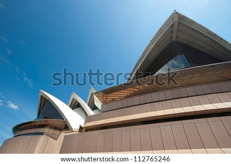 SYDNEY - JANUARY 8: The Iconic Sydney Opera House, became a UNESCO World Heritage Site on 28 June 2007 sits on the edge of Circular Quay. January 8, 2012 in Sydney, Australia. - stock photo