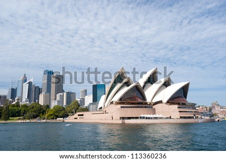 SYDNEY - JANUARY 10: The Iconic Sydney Opera House is a multi-venue performing arts centre also containing bars and outdoor restaurants. January 10, 2012 in Sydney, Australia. - stock photo