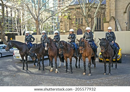 Sydney - July,06: Sydney mounted police officers on horse back ready to protect public at downtown in Sydney, Australia on July, 06,2014 - stock photo