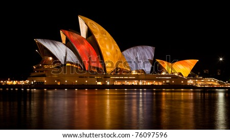 SYDNEY - JUNE 20: Various artists project their designs onto the Sydney Opera House during the Vivid Sydney Festival June 20, 2010 in Sydney, Australia. - stock photo