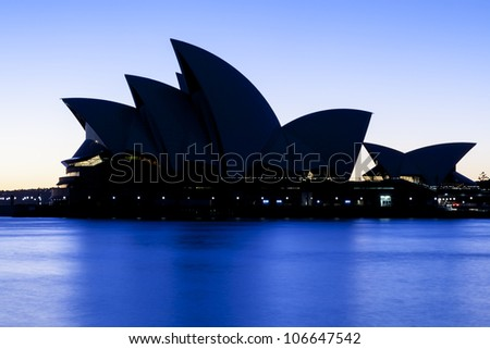SYDNEY - MARCH 22: Sydney's most famous icon, the Sydney Opera House in the morning sunlight on March 22,2012 in Sydney, Australia. The Opera House will celebrate its 40th anniversary in 2013. - stock photo
