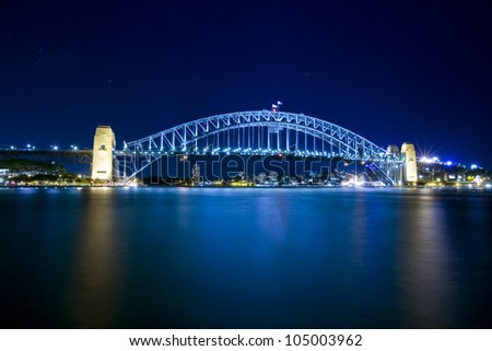 SYDNEY - MARCH 26: The Sydney Harbour Bridge in Sydney, Australia on March 26,2012. The Harbour Bridge is the world's widest long-span bridge. - stock photo
