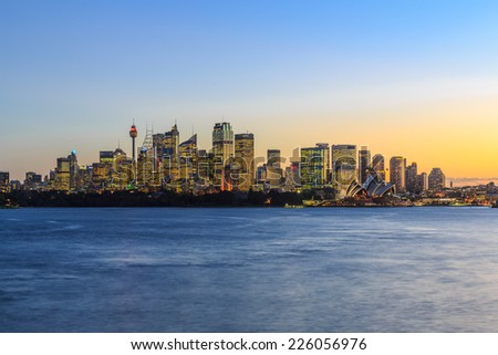 SYDNEY - MAY 14: City scape of Sydney at twilight on May 14, 2014 in Sydney. It is the state capital of New South Wales and the most populous city in Australia. - stock photo