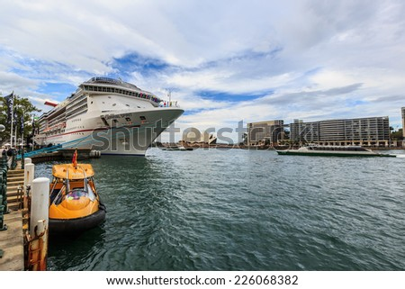 SYDNEY - MAY 10: Cruise ship at Sydney harbour on May 10, 2014 in Sydney. Sydney harbour is the maritime hub for the city of Sydney, Nova Scotia. Located on the South Arm. - stock photo