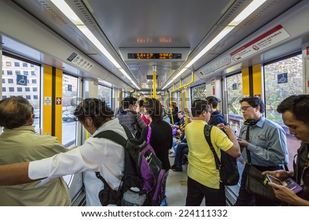 SYDNEY - MAY 16: Passengers in Light Rail on May 16, 2014 in Sydney. Sydney Trains is owned by the Government of New South Wales and operates all passenger rail services in metropolitan Sydney. - stock photo