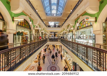 SYDNEY - MAY 15: People shop at Queen Victoria Building (QVB) on May 15, 14 in Sydney. It is a late nineteenth-century building designed by the architect George McRae in Sydney, Australia. - stock photo