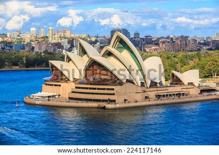 SYDNEY - MAY 11: Sydney Opera House on May 11, 2014 in Sydney. It is Identified as one of the 20th century's most distinctive buildings and one of the most famous performing arts centres in the world. - stock photo
